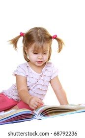 Cute little girl reading book isolated on white