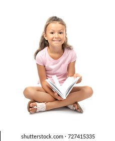 Cute little girl reading book on white background