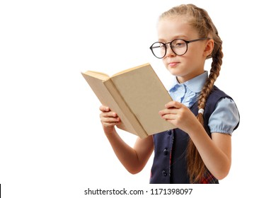 Cute little girl reads a book while wearing glasses, isolated on white