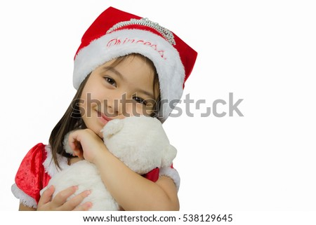 6843e6c3b Cute little girl in red Christmas dress and Santa hat on white background