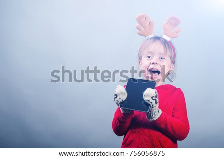 209e0b69a Cute Little Girl Red Sweater Horns Stock Photo (Edit Now) 756056875 ...