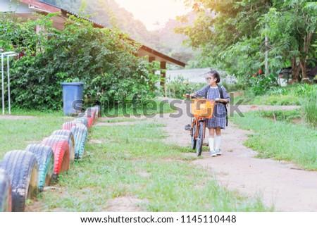 cute little girl riding bike go to school - Image