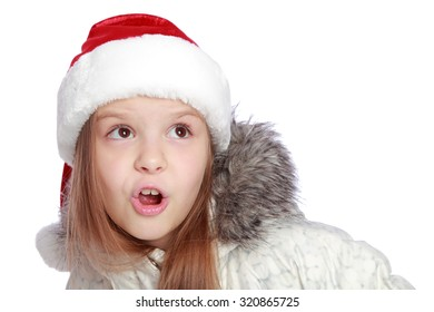 Cute little girl in the santa claus hat