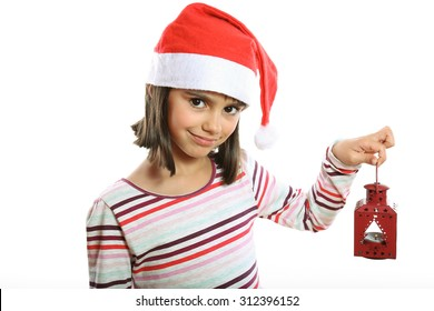 Cute little girl with Santa hat holding a red lantern smiling