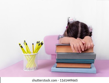 Cute little girl in school uniform sleeps on books.Selective focus and copy space for editing