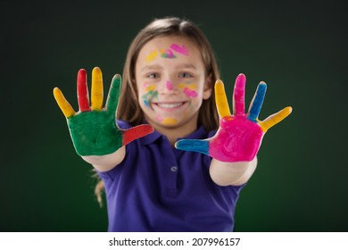 cute little girl showing hands. small girl with colorful hands and fingers
