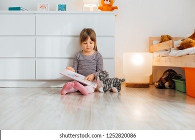 Cute little girl showing her drawing at home
