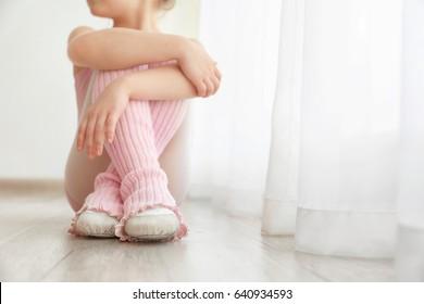 Cute little girl sitting at dance class