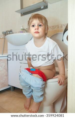 Little Girl Sitting On Toilet Stock Photo - Image of