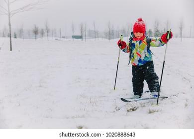 cute little girl ski in winter snow nature