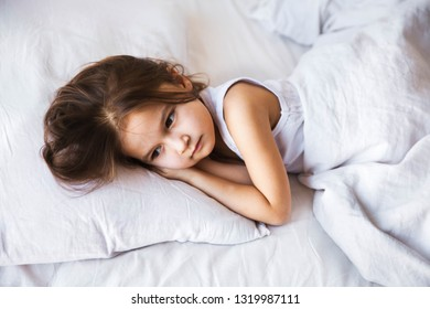 cute little girl sleeping in her bed at home