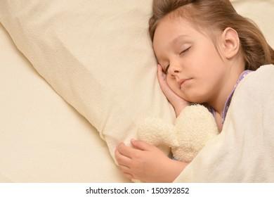 Cute little girl sleeping  in her bed