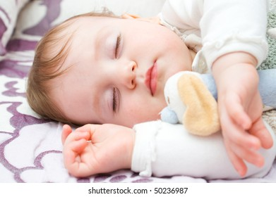 Cute little girl sleeping with toy