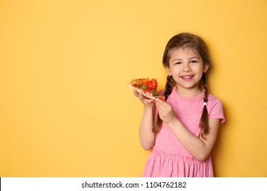 Cute little girl with slice of pizza on color background