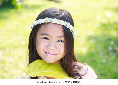 Cute little girl smiling and happiness in park vintage style