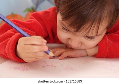 cute little girl studying  at the table at home