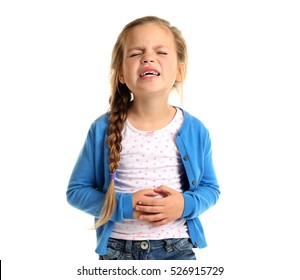 Cute little girl suffering from stomach ache, isolated on white