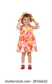 Cute little girl in summer dress on white