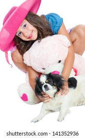 cute little girl with a teddy bear and pekingese