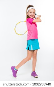 Cute little girl with tennis racket in her hands on white background