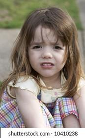 a cute little girl that is upset