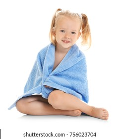 Cute little girl with towel on white background