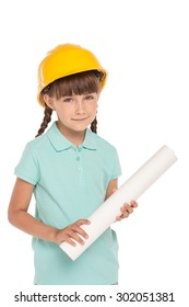 Cute little girl with two braids is isolated on white background. Girl looking at camera, wearing yellow helmet and holding whatman paper