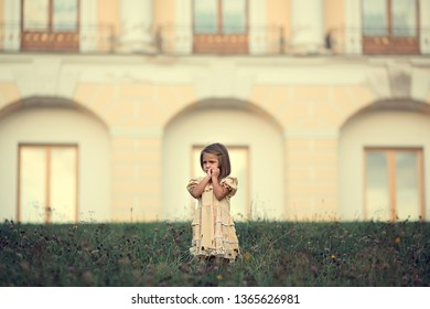 Cute little girl walking in the park. Image with selective focus and toning.