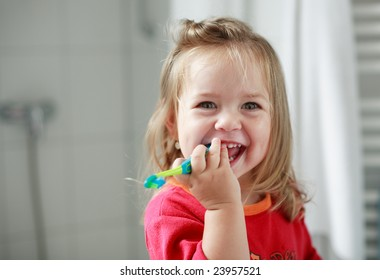 Cute little girl washing her teeth