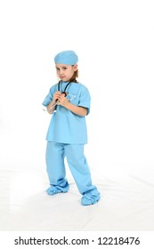 Cute little girl wearing blue scrubs and holding onto a stethoscope.