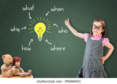 Cute little girl wearing business dress and analyzing problem and find solution, on green chalk board.