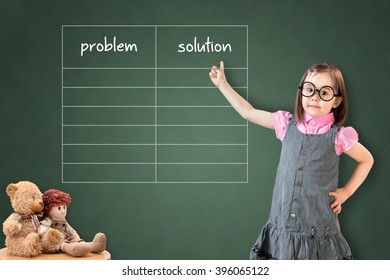 Cute little girl wearing business dress and showing problem and solution list in blank on green chalk board.