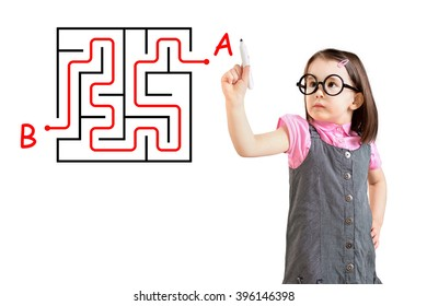 Cute little girl wearing business dress and finding the maze solution writing on the whiteboard. White background.