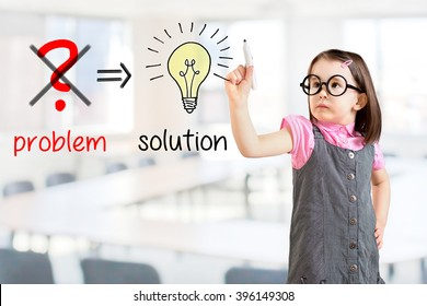 Cute little girl wearing business dress and eliminate problem and find solution. Office background.