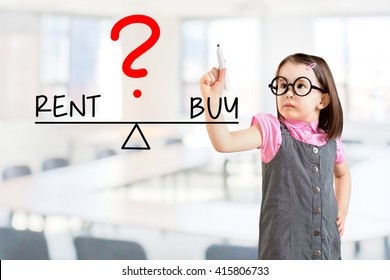 Cute little girl wearing business dress and writing rent and buy compare on balance bar. Office background.