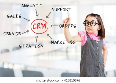 Cute little girl wearing business dress and drawing customer relationship management process concept. Office background.