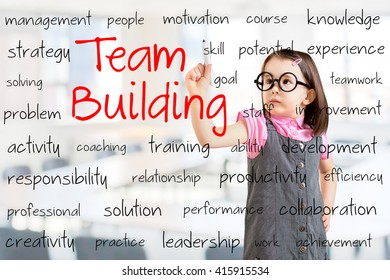 Cute little girl wearing business dress and writing team building concept. Office background.