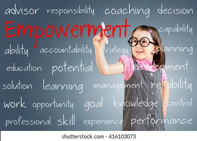 Cute little girl wearing business dress and writing empowerment concept. Blue background.