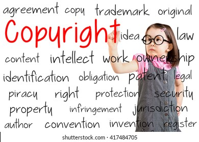 Cute little girl wearing business dress and writing copyright concept. White background.