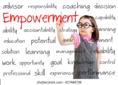 Cute little girl wearing business dress and writing empowerment concept. White background.