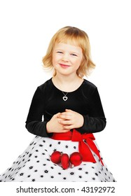 Cute little girl wearing a  dress sitting with christmas decoration, isolated on white background.