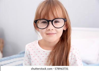Cute little girl wearing glasses