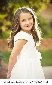 Cute little girl wearing a white dress