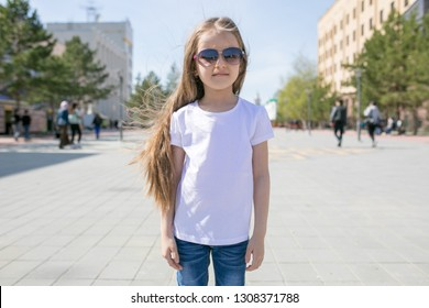 Cute little girl in white t-shirt. Mock-up.
