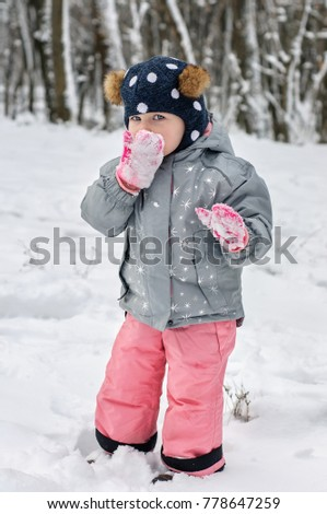 604748603 Cute Little Girl Winter Clothes Stands Stock Photo (Edit Now ...