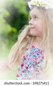 Cute little girl with a wreath of flowers in her blonde hair. Textured picture in vintage style.