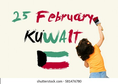 Cute little girl writing KUWAIT National Day25 February with Kuwait Flag using painting brush on wall background