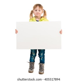 cute little girl in yellow coat with blank sheet in hands isolated on white background