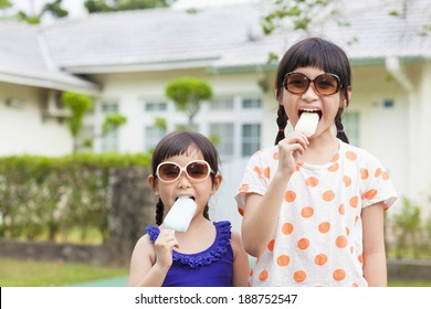 Cute little Girls  Eating Ice Cream before their house