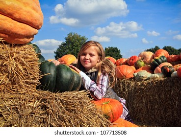 Cute little girls in a pumpkin patch